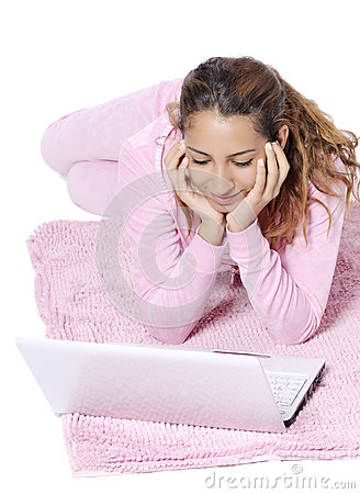 Happy woman looking backward with laptop