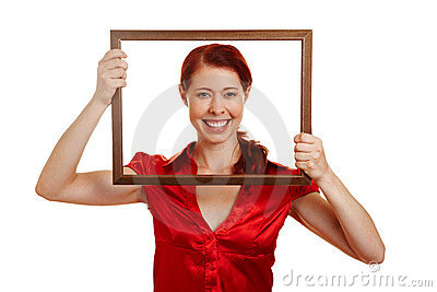 Happy woman looking through frame