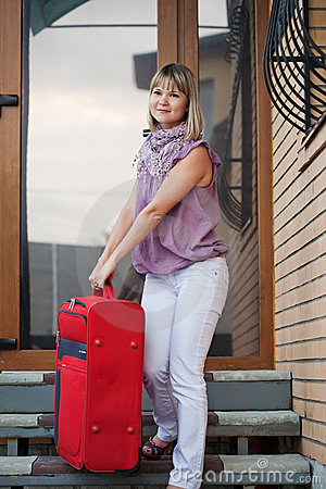 Happy woman with luggage