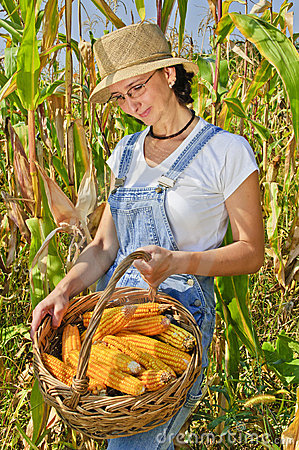 Happy woman with maize basket
