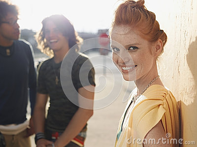 Happy Woman With Male Friends In Background