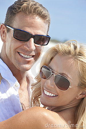 Happy Woman Man Couple In Sunglasses At Beach