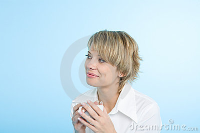 A happy woman at morning with a cup of coffee