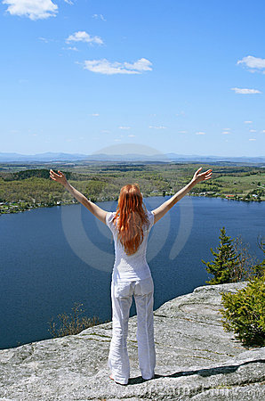Happy woman on the mountain