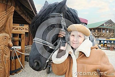 Happy woman near horse