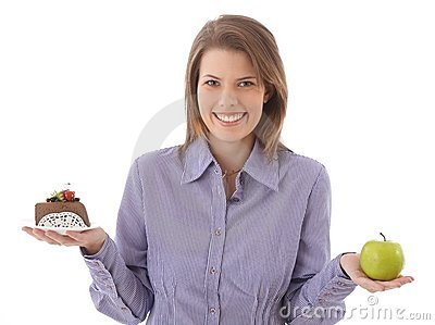 Happy woman offering cake and apple Stock Photo