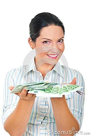 Happy woman offering money