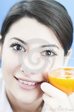 Happy woman with the orange juice