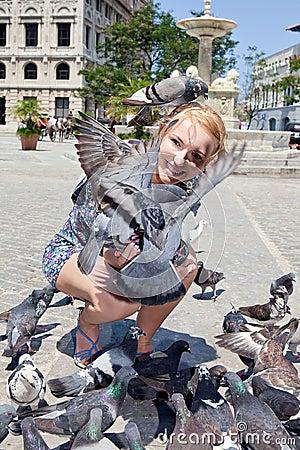 Happy woman with pigeons in Havana