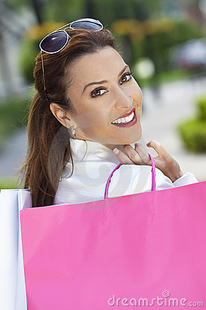 Happy Woman With Pink and White Shopping Bags