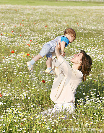 Happy woman playing with son