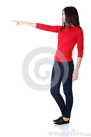 Happy woman pointing on copy space