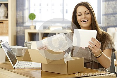 Happy woman with postal packet