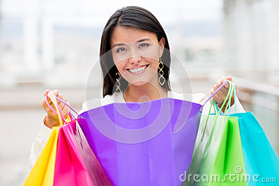 Happy woman with purchases