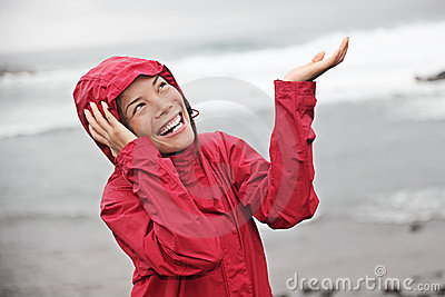 Happy woman on rainy day