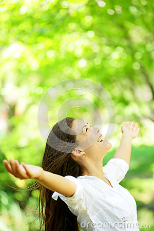 Happy woman rejoice looking up happy