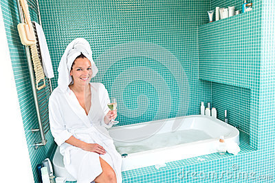 Happy woman relaxing bathroom spa wellbeing hotel