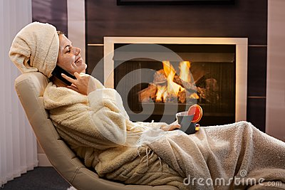 Happy woman relaxing in beauty mask