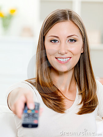 Happy woman with remote control sitting