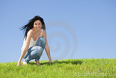 Happy woman rest on the green grass