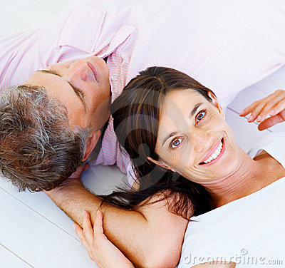 Happy woman resting her head on her husband s arm