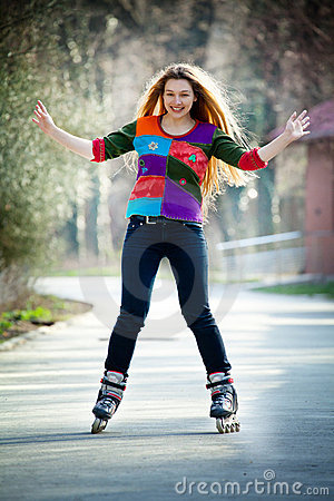 Happy woman on roller skates