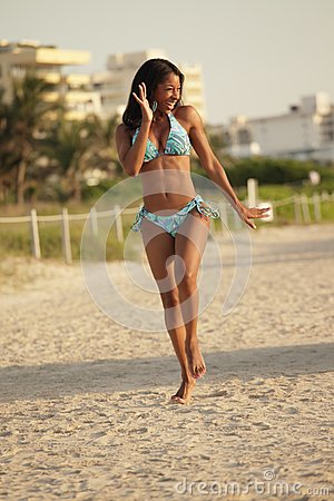 Happy woman running on the beach