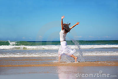 Happy woman running in sea