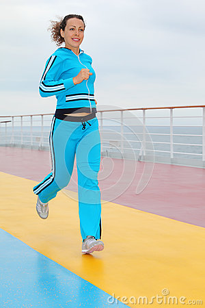 Happy woman runs on cruise liner deck