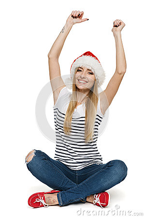 Happy woman in Santa hat with arms raised