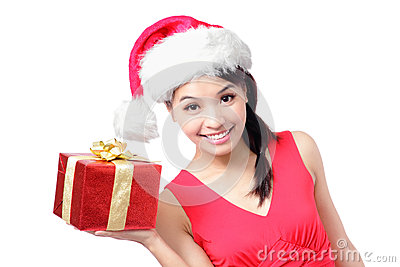 Happy woman in santa hat showing Christmas present