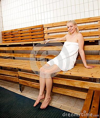 Happy Woman in Sauna