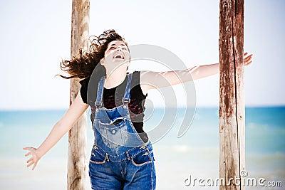 Happy woman by sea