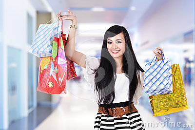 Happy woman with shooping bags