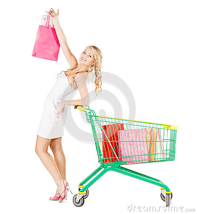 Happy woman with shopping cart and bags