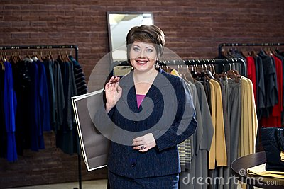 Happy woman shopping in clothes store