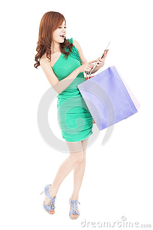 Happy  woman shopping on the internet by tablet pc