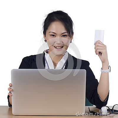Happy woman shopping online paying with credit card.