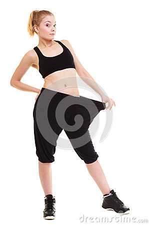 Free Happy Woman Showing How Much Weight She Lost, Big Pants Royalty Free Stock Photos - 35314258