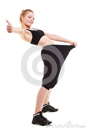 Free Happy Woman Showing How Much Weight She Lost, Big Pants Stock Photos - 35340513