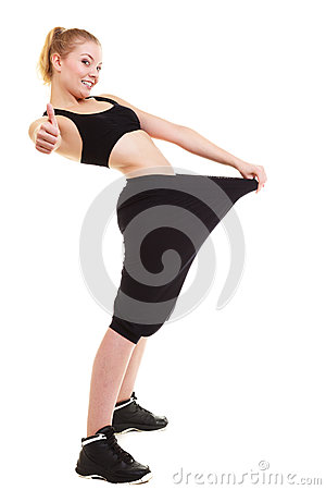 Free Happy Woman Showing How Much Weight She Lost, Big Pants Stock Photography - 35766542
