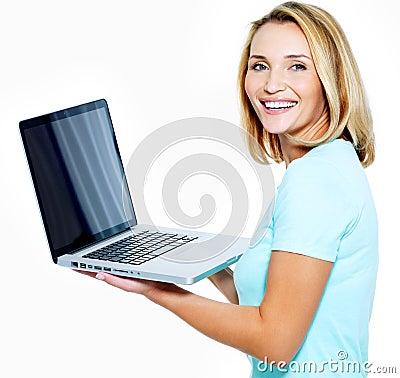 Happy woman showing laptop