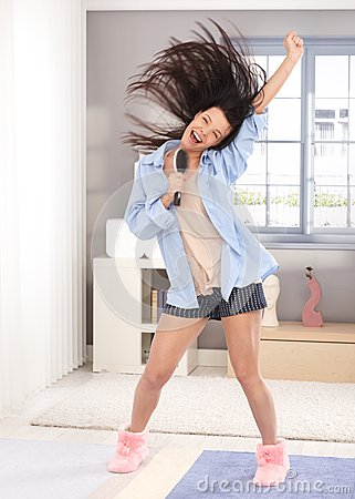 Free Happy Woman Singing To Hairbrush In The Morning Royalty Free Stock Image - 25341036