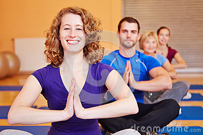 Happy woman smiling in yoga class