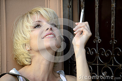 Happy woman smoking a cigarette