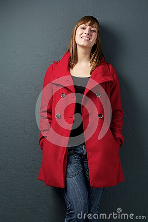 Happy woman standing on gray background