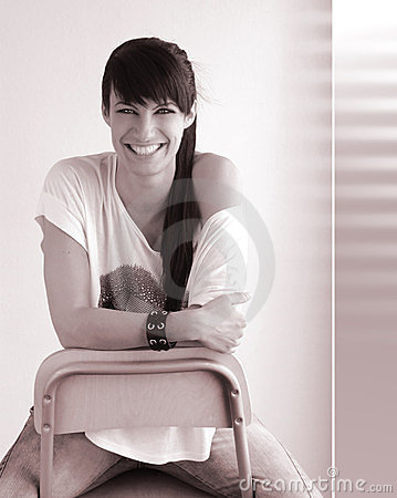 Happy woman in stool