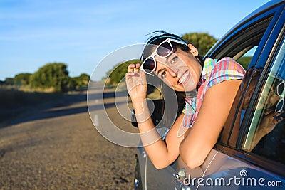 Happy woman on summer car travel