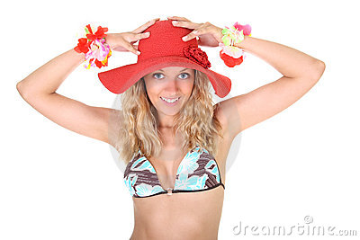 Happy woman in swimsuit with red hat