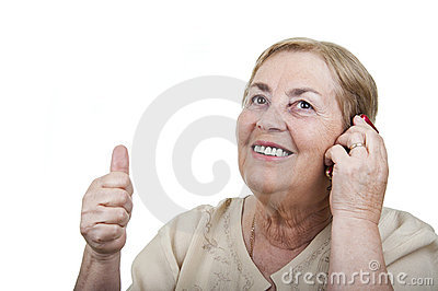 Happy woman talking at cellphone with thumb up